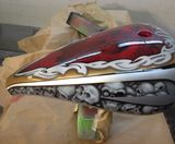 Custom painted chopper tank candy apple red airbrushed skulls triba